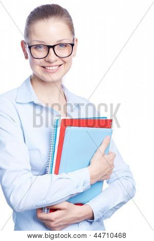 Portrait of happy student in eyeglasses holding books and looking at camera with smile