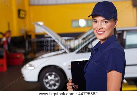 beautiful cheerful female auto garage manager portrait inside workshop
