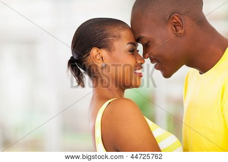 close up portrait of young african american couple flirting
