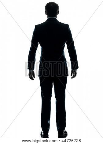 one caucasian businessman standing rear view  in silhouette studio isolated on white background