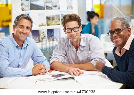 Group Of Men Meeting In Creative Office