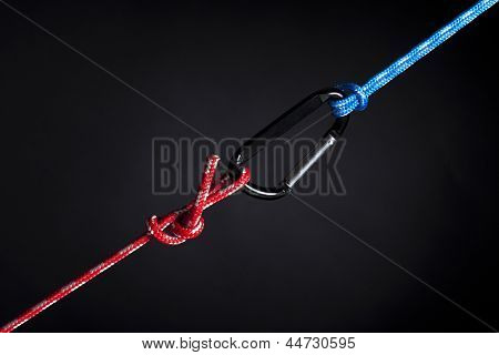 red and blue ropes connected with carabiner hook