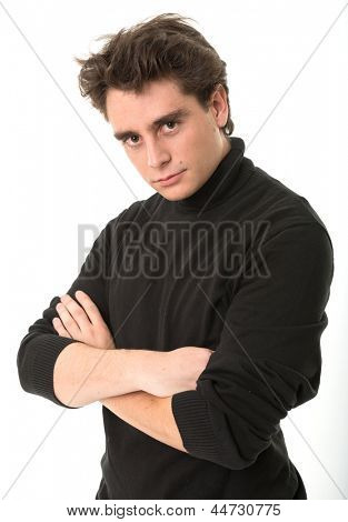 Serious young man in black turtleneck
