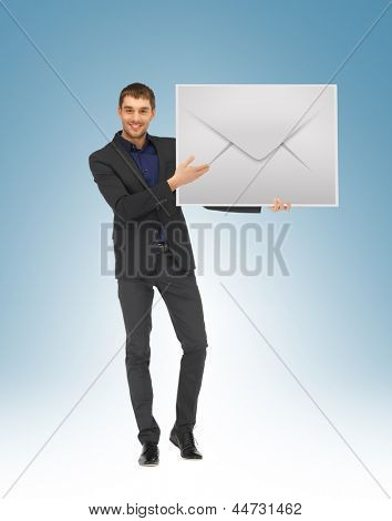 picture of handsome man showing virtual envelope