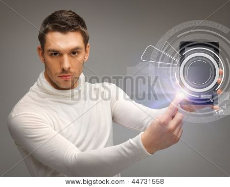 man with tablet pc touching virtual screen