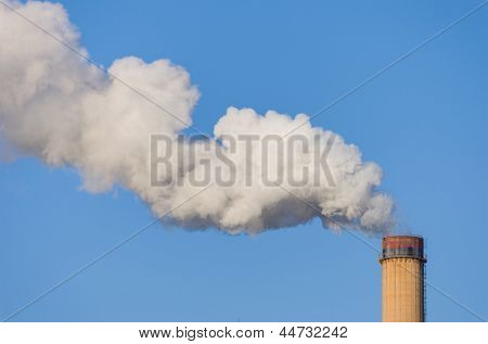 smokestack releasing pollution on clear blue sky - easy to create mask