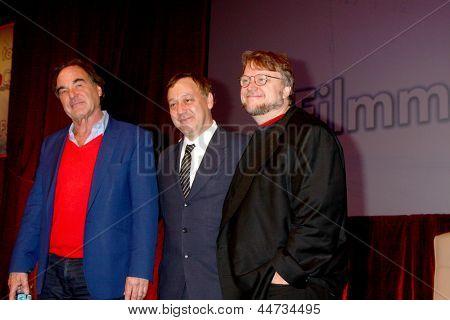 LAS VEGAS - APR 17:  Oliver Stone, Sam Raimi, Guillermo del Toro at the CinemaCon Filmmaker's Luncheon at the Caesars Palace on April 17, 2013 in Las Vegas, NV