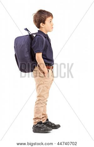 Full length portrait of a school boy with backpack standing, isolated on white background