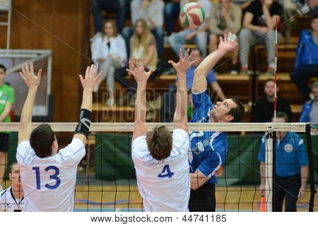 KAPOSVAR, HUNGARY - APRIL 15: Andras Geiger (in blue) in action at a Hungarian National Championship volleyball game Kaposvar (blue) vs. Kecskemet (white), April 15, 2013 in Kaposvar, Hungary.