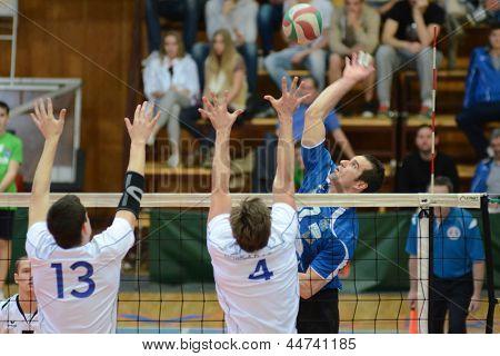 KAPOSVAR, HUNGARY - APRIL 15: Andras Geiger (in blue) in action at a Hungarian National Championship volleyball game Kaposvar (blue) vs. Kecskemet (white), April 15, 2013 in Kaposvar, Hungary.