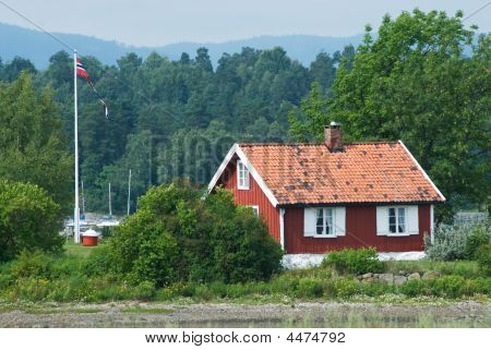 Small, Red House In Norway