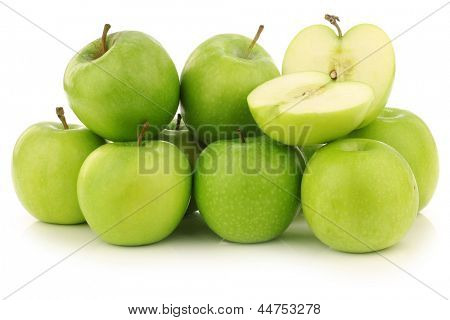 "freshly harvested ""Granny Smith"" apples and a cut one  on a white background"
