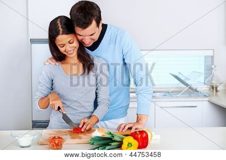 couple prepare food together in kitchen. healthy lifestyle relationship