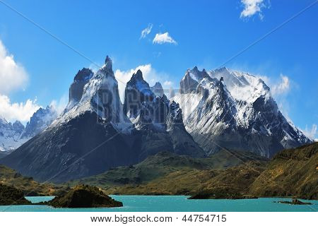 Epic beauty of the landscape - the National Park Torres del Paine in southern Chile. Cliffs of Los Kuernos in cold windy summer day