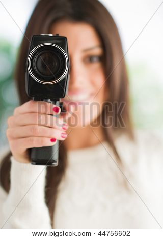 Portrait Of Woman Using Camcorder, Outdoors