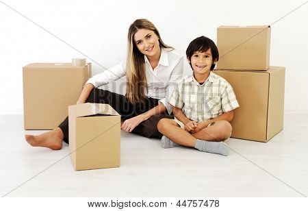 Young women and little boy  playing with cardboard box