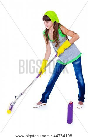 Teenager cleaning floor with a mop