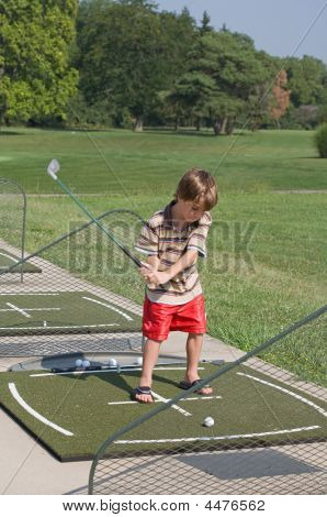 Little Boy Learning To Golf