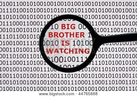 Internet security concept the words big brother is watching on a digital tablet screen with a magnifying glass