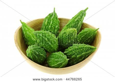 A Bowl of fresh green Bitter Cucumber (Balsum Pear), isolated on white background