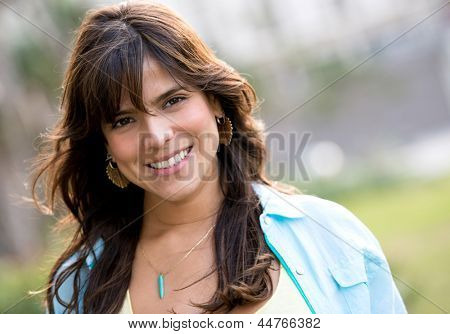Beautiful casual woman smiling at the park