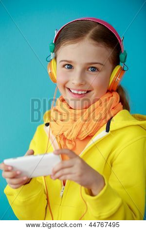 Lifestyle of young people concept - Young girl with headphones listening music, happy young girl.