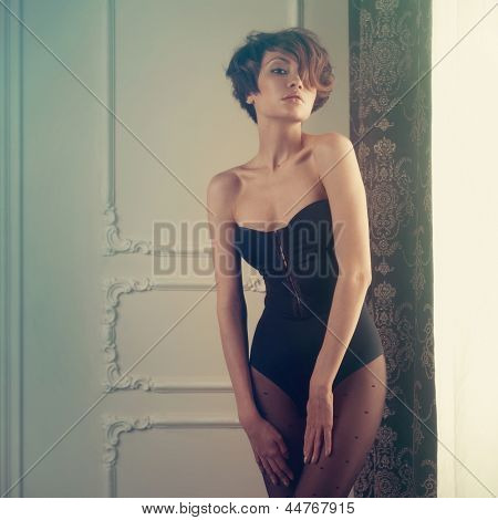 Fashion art photo of young sensual lady in classical interior