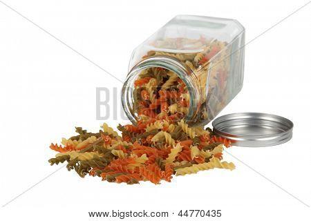Pasta falling from jar