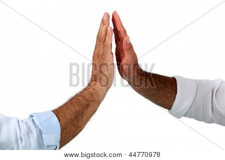 Two businessmen giving each other high fives