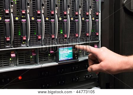 Man controls the rack with a hard drives.