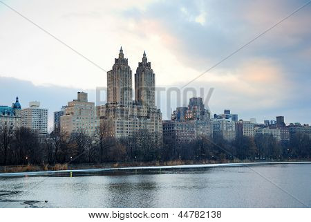 New York City Skyline over lake in Central Park at dusk