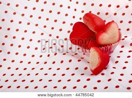 Marzipan candy heart  on retro Vintage polka dot napkin background