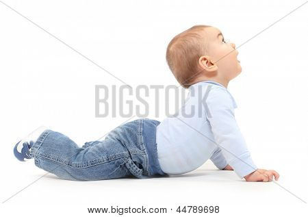 Funny toddler boy playing on a white background.