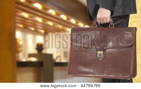 Businessman with briefcase in the hotel reception