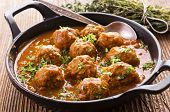 stock photo of meatball  - meatballs cooked in tomato sauce - JPG
