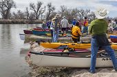 SOUTH PLATTE RIVER, EVANS, COLORADO - APRIL 6: Preparing kayaks and canoes for a launch during Annua