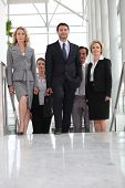 stock photo of tight dress  - Group of executives climbing stairs - JPG