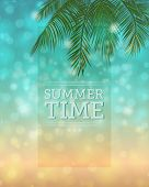Summertime Background - Bokeh background with palm tree leaves and the sparkling sea and sandy beach