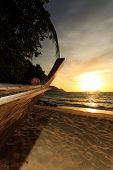 Beautiful sunrise in Rawai Phuket island Thailand with Long tailed boat Ruea Hang Yao