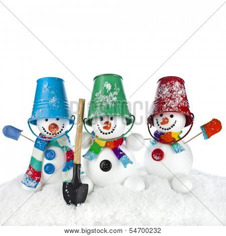 Cheerful snowman with red color bucket on his head and shovel in hand isolated on white background