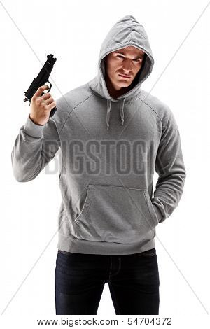 Young male with hood over his head holding a gun, symbolizing crime isolated on white background