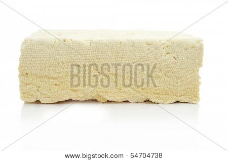 a block of tofu on a white background