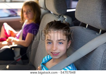 Kid children girls with safety belt in car vehicle indoor