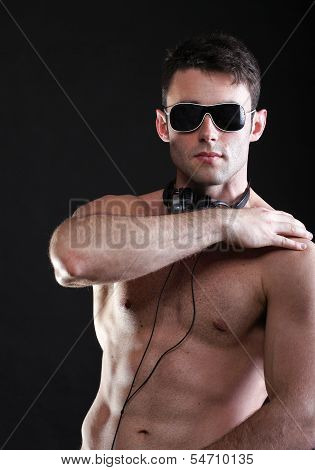Handsome Man Listening To Music On Headphone