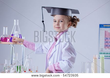Cute little laboratorian posing in graduate hat