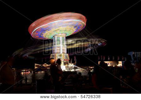 A Ferry wheel in motion in Carnival