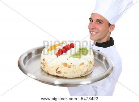 Man Chef Holding Cake (focus On Man)