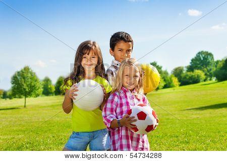 Team Of Three Happy Kids With Balls