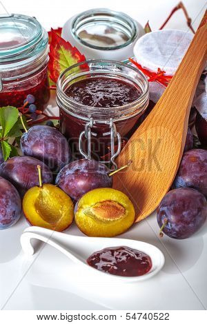 Plum Jars And Fruits