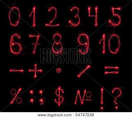 Fireworks numbers and symbols on black background